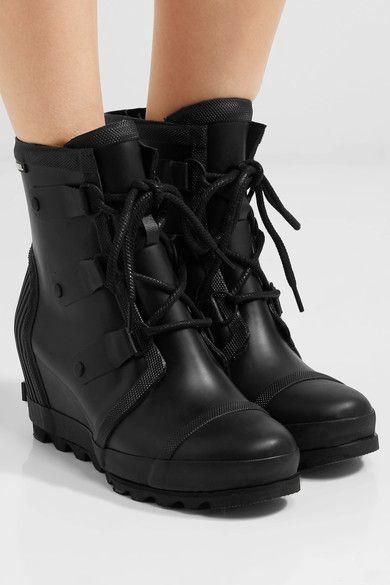 Wedge heel measures approximately 75mm/ 3 inches with a 30mm/ 1 inch platform Black rubber Lace-up front Designer color: Black Sea Salt