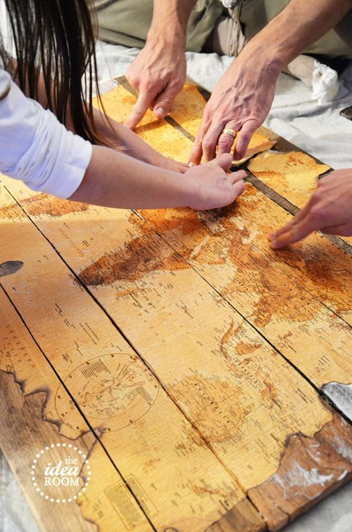 tea stain an old map, nail board together and decoupage onto pallets. Hang in garden as decor or add to house