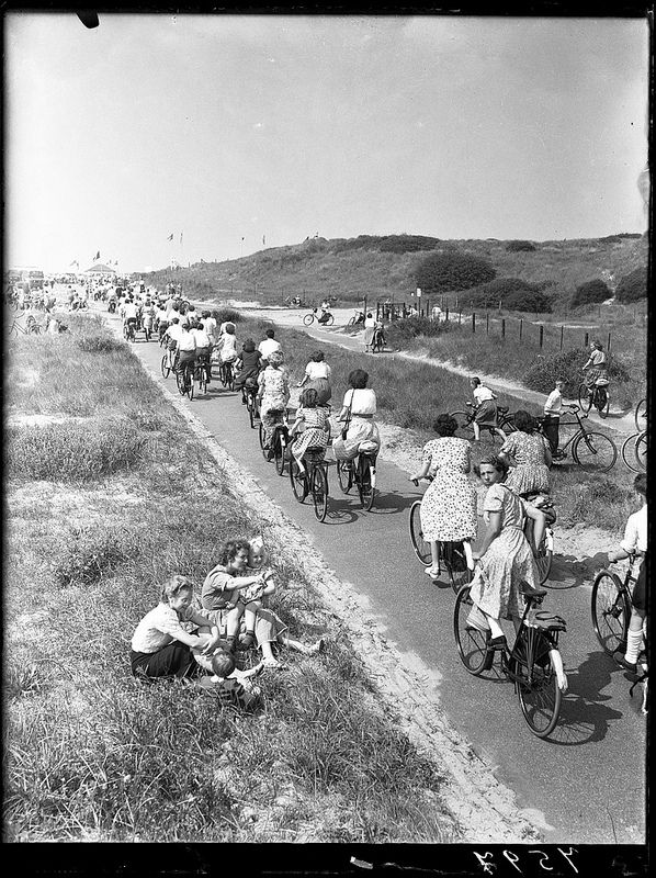 1950. In the early 50's the bike was for most people the primary transportation vehicle to get from Amsterdam to the beaches. On warm sunny days the bicycle paths to Zandvoort and Bloemendaal at the Sea were often jammed. Here people are on their way to Bloemendaal at the Sea. Foto Ben van Meerendonk / AHF, collectie IISG, Amsterdam #amsterdam #1950
