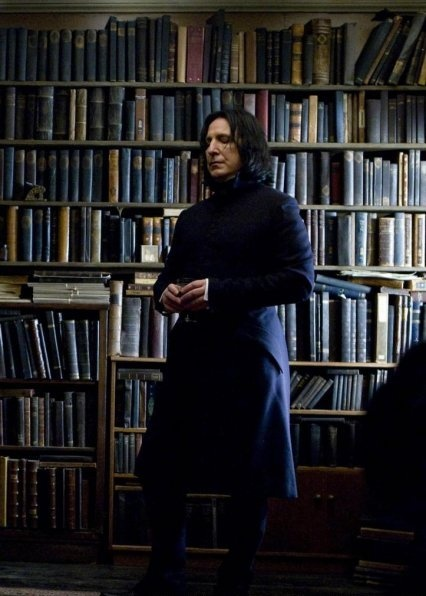 Snape surrounded by his books.