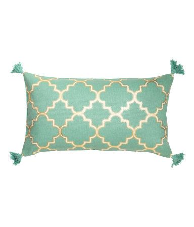 Turquoise. Cushion cover in thick, woven cotton fabric with a printed pattern on one side, tassels at corners, and concealed zip.