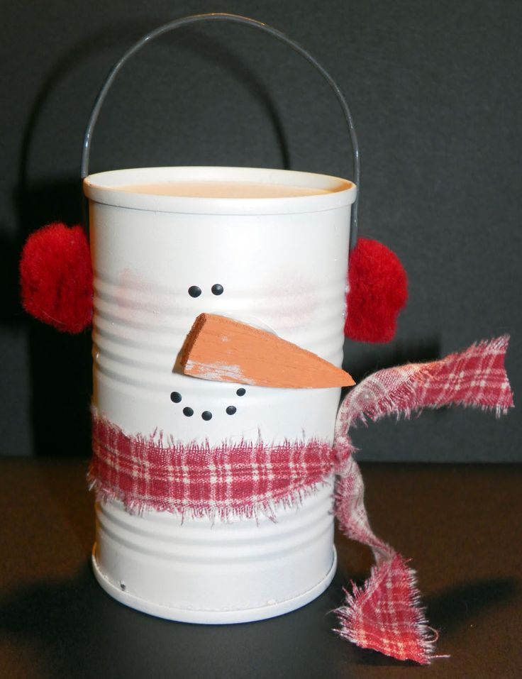 How about a snowman made from a tomato paste can? The hanger is a piece of thick floral wire. The nose is a piece of wood, but you could use a piece of craft foam.
