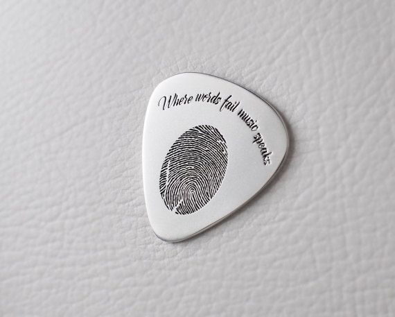 ACTUAL FINGERPRINT/HANDWRITING GUITAR PICK This guitar pick is personalized with actual fingerprint/handwriting  -------- ENGRAVING ------- (please read below for what can be engraved for each STYLE. select the STYLE you want from drop down menu on the right)  STYLE 1: *Front: 0-4 words and 1 fingerprint; *Back: blank  STYLE 2: *Front: 0-4 words and 1 fingerprint; *Back: 1-6 words  STYLE 3: *Front: 0-4 words and 1 fingerprint; *Back: 0-4 words and 1 fingerprint  STYLE 4: *Front: 0-2 word and…