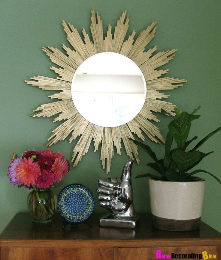 Loving the gilded touch on this sunburst mirror crafted from wood shims.  Source: K Sarah Designs