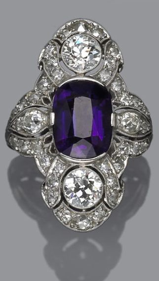 An art deco amethyst and diamond ring, circa 1925 centering an oval-shaped amethyst; signed D. Co.; estimated total diamond weight: 2.50 carats; mounted in platinum.