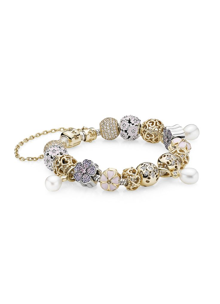Mix gold, silver, pearls and flowers charms for an exclusive and feminine look. #PANDORA #PANDORAbracelet
