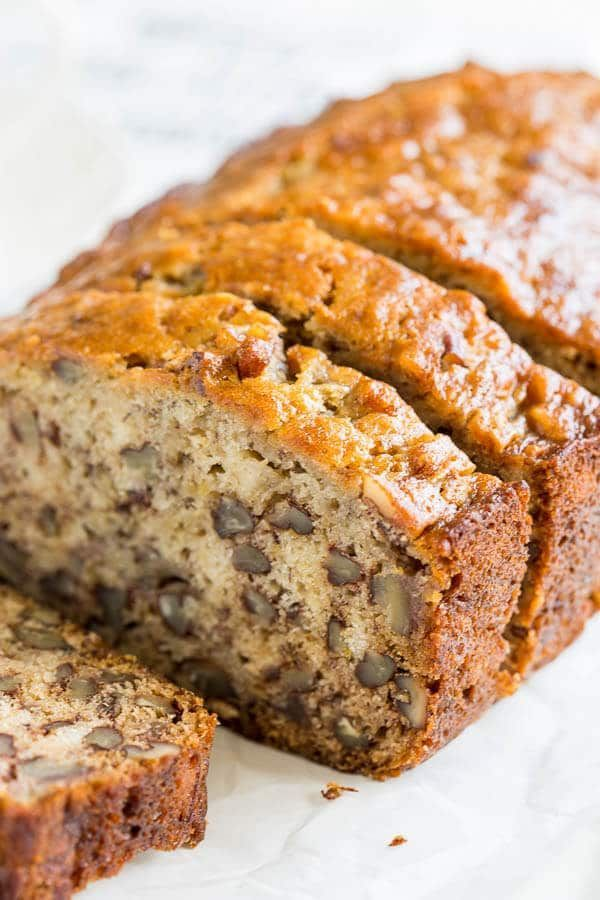 This quick easy banana bread recipe is our family's favorite. The fool-proof way to the most tender and flavorful banana bread, you'll ever have.