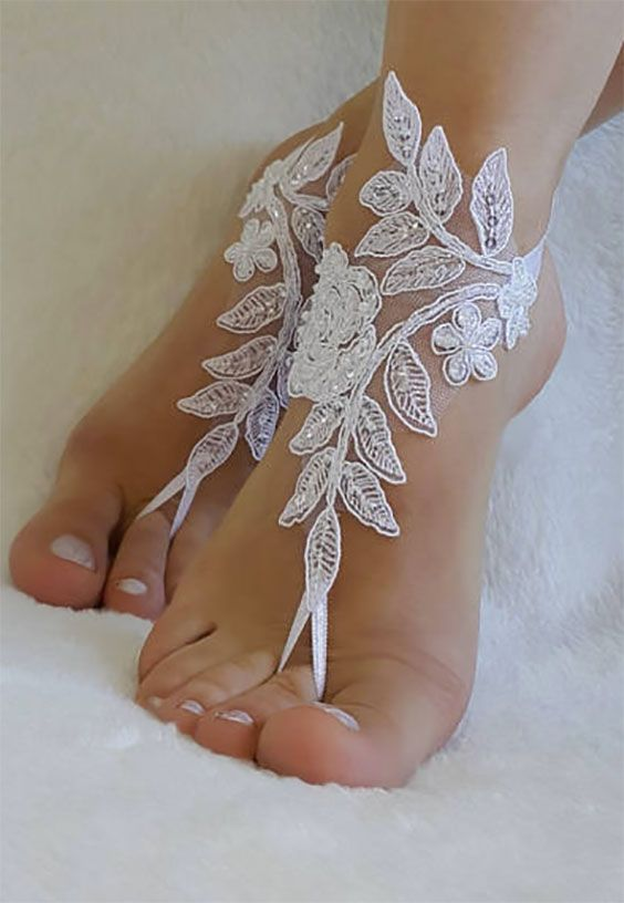 Barefoot sandals for wedding or the beach. These would be so cute for the bride and as bridesmaids gifts. Anna makes these with French lace, with little sequins and pearls, and in all shoe sizes. If you want you can get the big rose in different colors besides white.