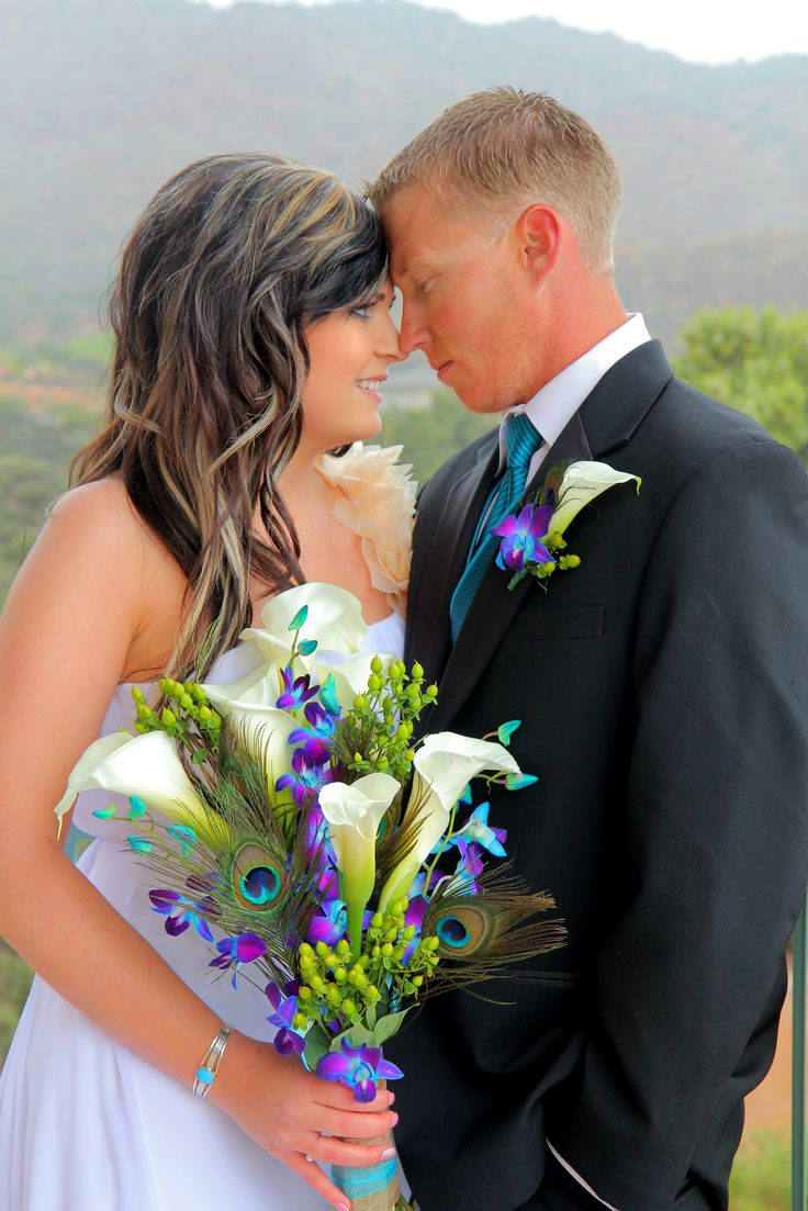 Peacock Wedding Colors | Bride & Groom with Peacock Bouquet | Peacock Teal & purple wedding colors www.cheapshotsllc.com Entire wedding for $350 with CD!