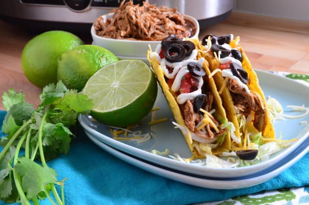 Slow cooker shredded chicken tacos is one of the easiest recipes you'll ever make. Five minutes of prep and a slow cooker is all you need!