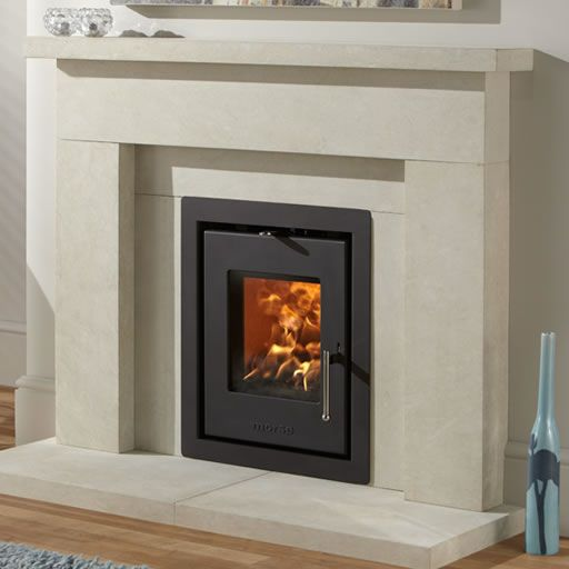 This stunning new multi-fuel Morsø S81-90 insert wood burning stove has been specifically designed with a UK standard fireplace opening in mind, making it an i