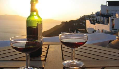 Enjoying the Greek sunset with the taste of a  traditional Greek wine!