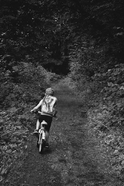 bwstock.photography - photo | free download black and white photos  //   #boy #cyclist