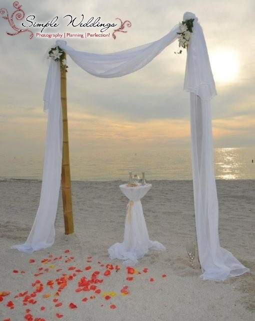 Our two-post bamboo arch adds a romantic touch to your beach wedding ceremony!