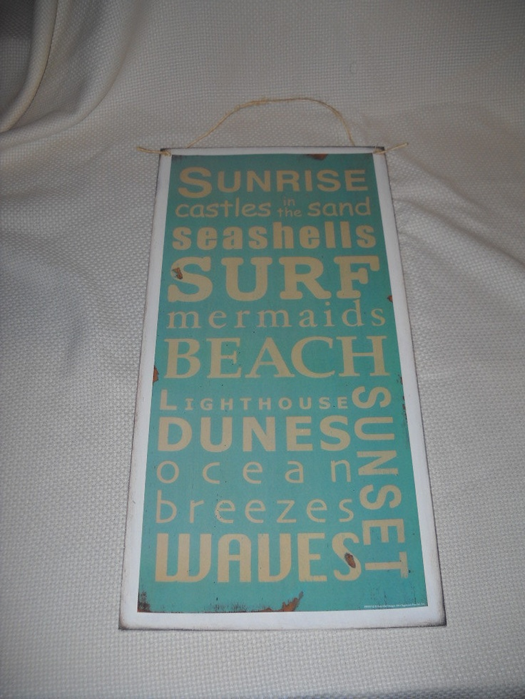 Beach Terms wooden wall art sign Seashells Surf Dunes Ocean Breezes Waves. $19.99, via Etsy.