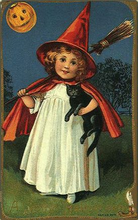 little witch victorian halloween card.  Who can resist a redhead holding a black cat????  Wink.