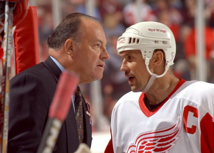 Steve Yzerman confers with Scotty Bowman on the bench. Photos are of the Detroit Red Wings' 4-2 loss to Calgary during the season's home opener. (The Detroit News/David Guralnick)