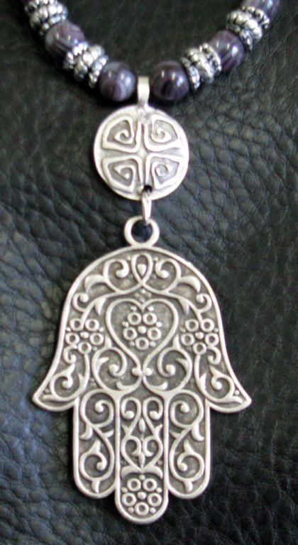 Hand of Fatima from Turkey.  This would be a lovely tattoo.  Henna colored ink maybe?