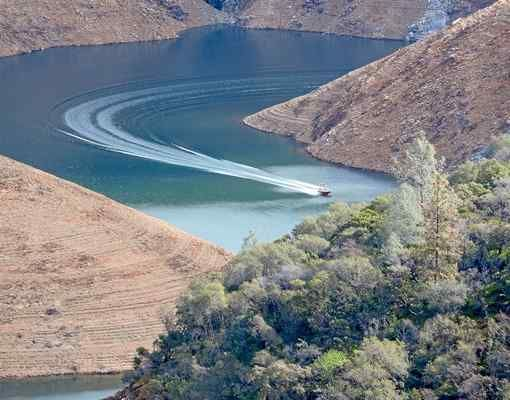"""Nice Curves: A boat makes a sweeping turn Sunday on Lake Oroville near the Nelson Bar day use area below Paradise. Readers can submit photos for consideration to """"Hot Shot"""" at photo@chicoer.com or tag their photos with #thisischico on Instagram."""