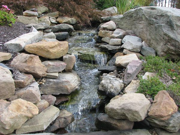 138 best outdoor stone landscaping ideas images on for Rock ponds designs
