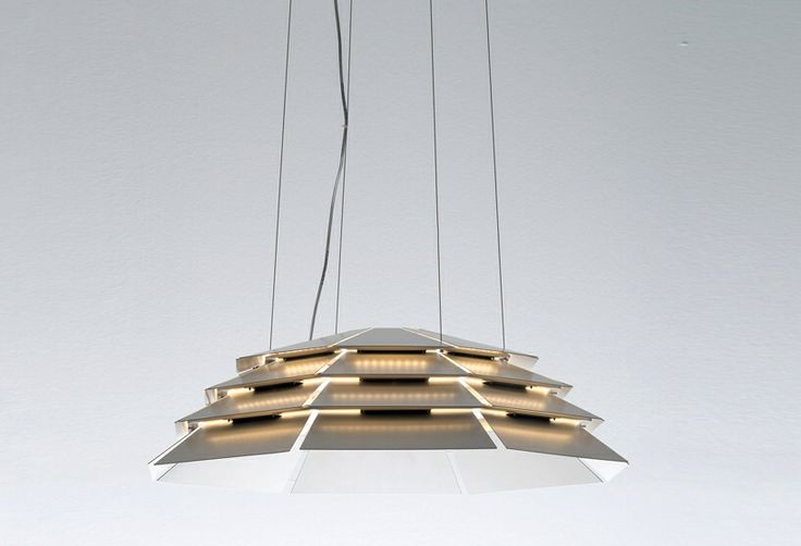 'melathron', pure structural engineering applied to lamp design by michele de lucchi for artemide. vertically connected by means of steel sheets. image © designboom