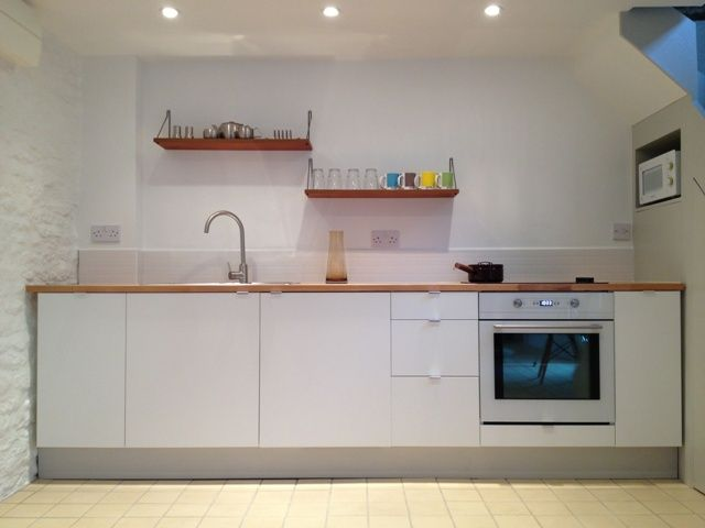 White, wood and grey kitchen