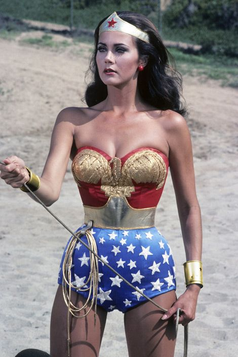 Modern    Lynda Carter as Wonder Woman wearing her magical Bracelets of Submission.