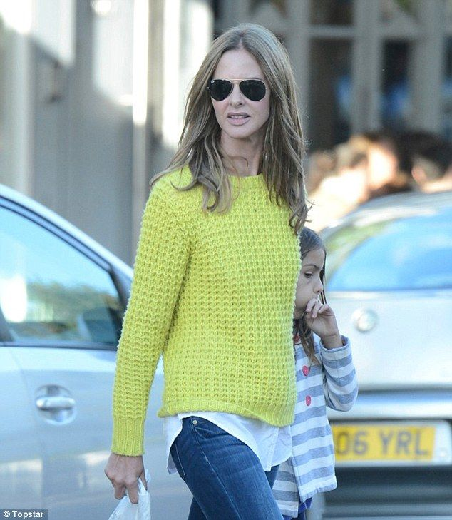 Neon: Trinny leaves a trendy cafe in west London with her daughter Lyla.