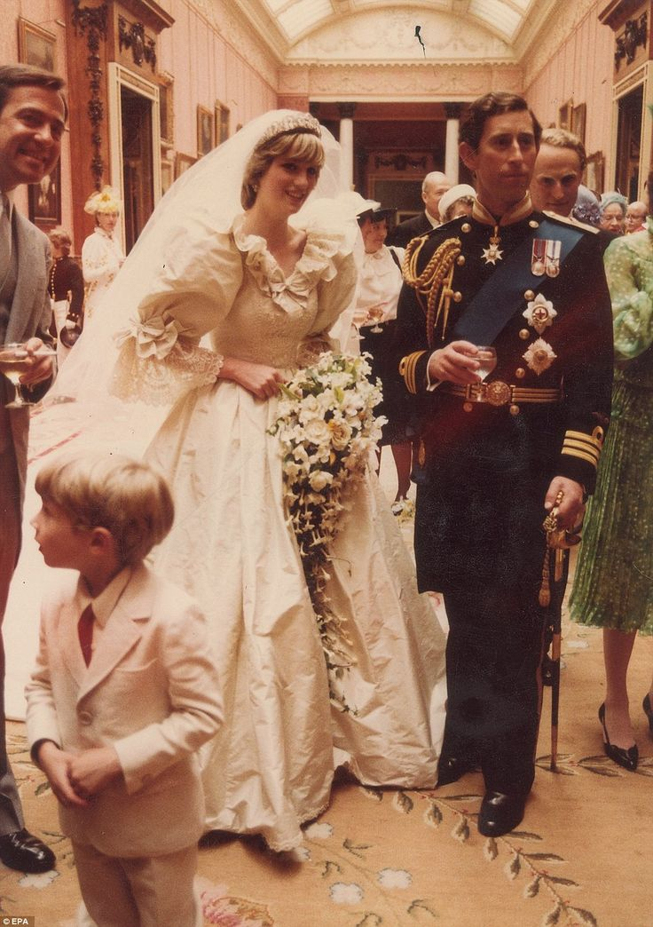 Happy couple: Prince Charles and Princess Diana are pictured enjoying their wedding reception at Buckingham Palace in July 1981
