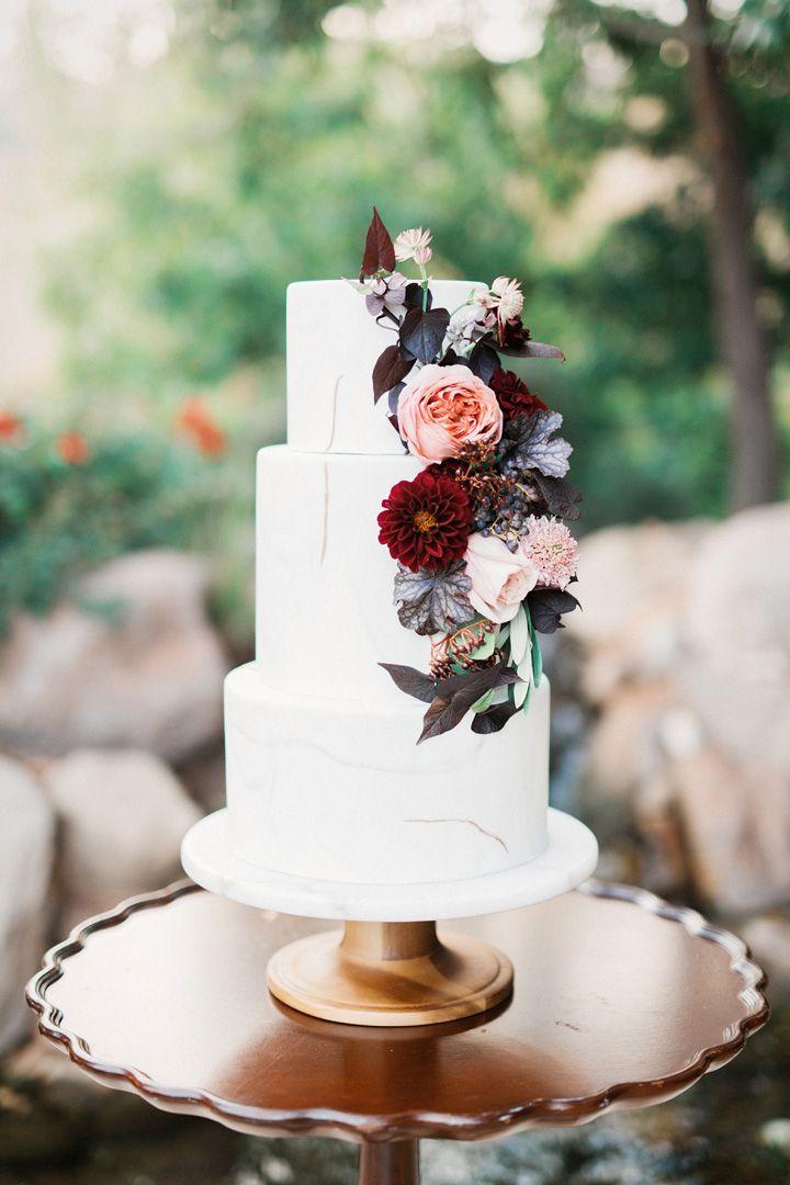 Burgundy and peach flowers on three tier wedding cake | fabmood.com #weddingtheme #bluewedding #weddinginspiration #weddingstyledshoot #weddingdesign
