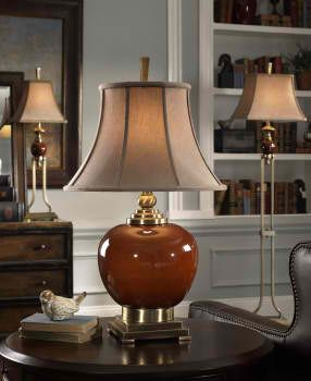 Daviel #TableLamp. This #lamp has a cinnamon red porcelain body with coffee bronze metal details. The round bell shade is a crushed, silkened, golden bronze textile. #lamp #LightsandLamps #homedecor #accentfurniture #ArtFurniture #CarolynKinder
