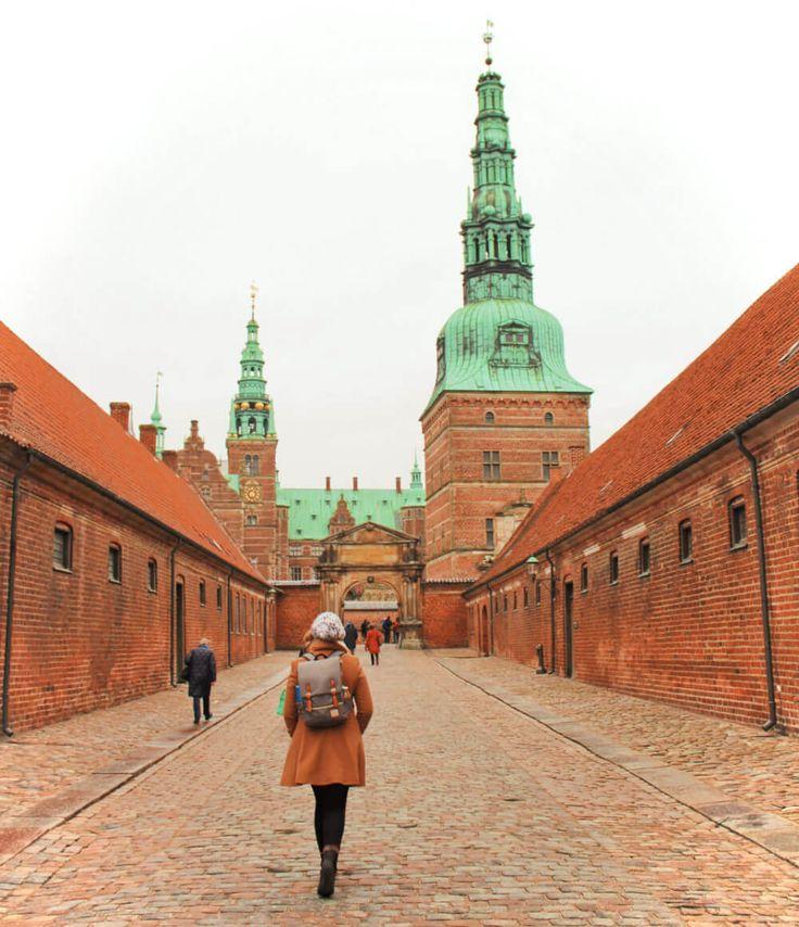 Exploring Frederiksborg Castle near Copenhagen, Denmark on a winter day. Visiting castles is one of the best day trips from Copenhagen in the winter!