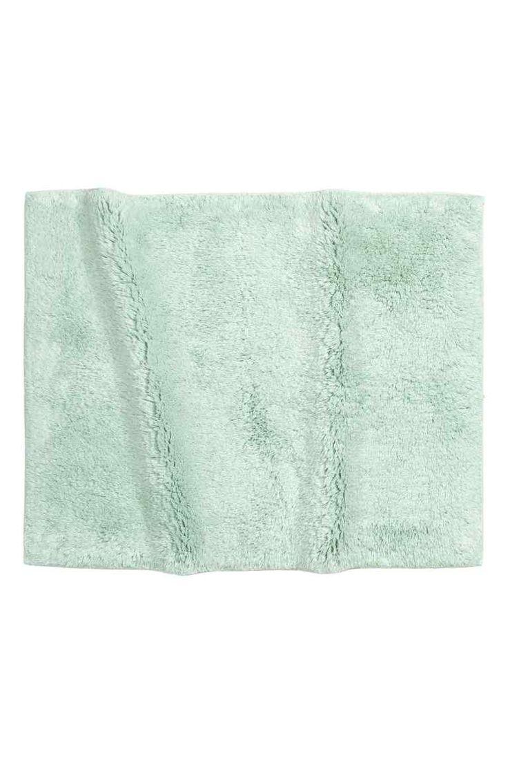 Tapis de bain: Tapis de bain en coton éponge épais. Modèle avec liséré sur le pourtour et envers anti-dérapant. Ne pas utiliser ce produit sur des surfaces réchauffées.