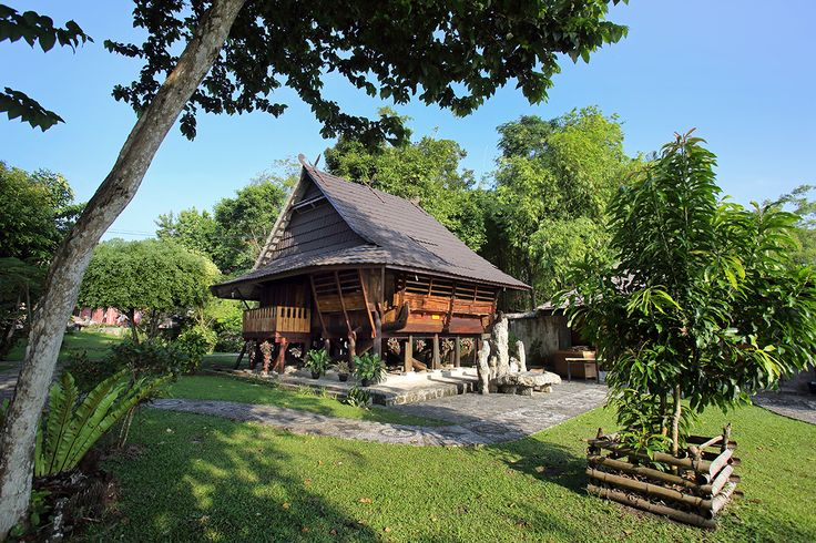Guest Lodges for tourists at Nias Heritage Museum (Museum Pusaka Nias) in Gunungsitoli. Several traditional houses are available for tourists as accomodation. Photo by Bjorn Svensson. www.visitniasisland.com