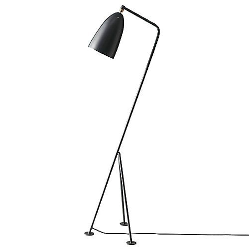 Originally designed in 1948 by Greta Grossman, the Gubi lighting Grasshopper Floor Lamp embodied the industrial and functional requirements heralded by European Modernism, instead offering a more refined version that could comfortably fit in chic residences. A zoomorphic fixture standing on a tripod angles the smooth aluminum shade in a unique way, combining both the figurative and abstract with direct lighting in mind. The shade is attached on a ball joint for adjustability, making the…