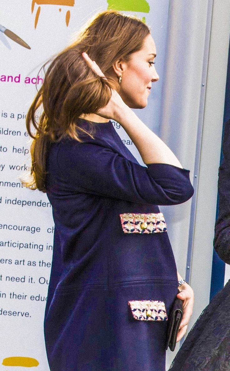 Kate's baby bump is clearly visible as the six-months pregnant duchess visits the Barlby Primary School, Jan. 15, 2015.