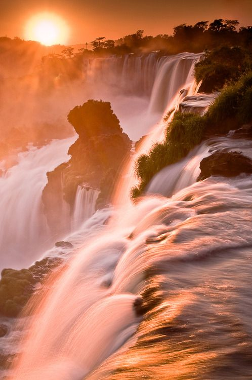 Rising sun and Iguazu Falls