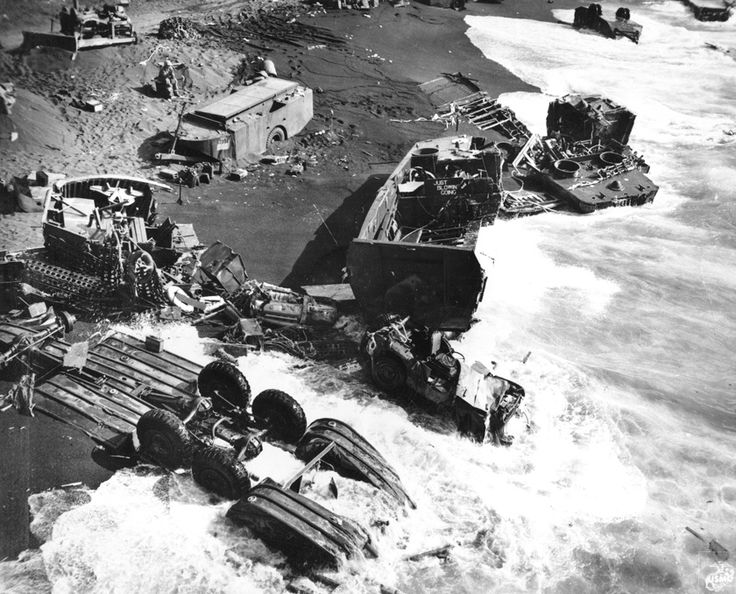 Beach wreckage, Iwo Jima, 1945. Photo caption: Closeup of wreckage of Marine equipment and landing barges partly submerged in the soft volcanic sand of the beach of Iwo Jima. From the Photograph Collection at the Marine Corps Archives and Special Collections OFFICIAL USMC PHOTOGRAPH