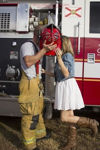 Central Florida Family Photographer Orlando Tabitha Sebren Photography fireman firetruck husband and wife kissing behind hat