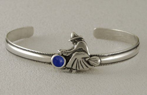 An Adorable Little Witch on a Sterling Silver Cuff Bracelet Accented with Genuine Lapis The Silver Dragon- Bracelets. $50.00. The Silver Dragon uses Sterling Silver that has been Reclaimed... Helping Save Mother Earth's Resources.. This Bracelet was Designed by The Silver Dragon, a Jewelry Shop in New England. Thank you for Supporting American Business.. This Bracelet Fits a Standard Woman's Wrist. Designed And Hand- Crafted in Sterling Silver. This Unique Bracelet is Create...