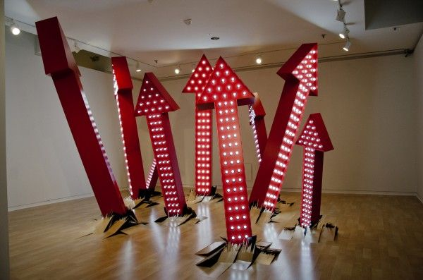 You Always Leave Me Wanting More, 2015  Aluminum, enamel, LED lightbulbs, electronics, flooring  27½ x 33 ft.  Commissioned and funded by 21c Museum Hotels and the Frye Foundation  You Always Leave Me Wanting More addresses the sustainability of growth as it pertains to aspects of our social, economic and natural environments. We have co-opted the stripped down language of commercial signs, incorporating casino style way-finders that tear through the floors of the museum with skyward…
