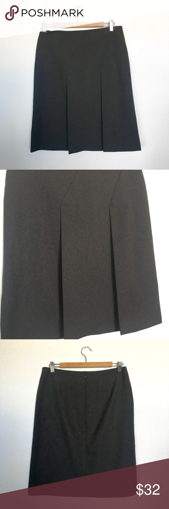 """United Colors of Benetton Short Pleated Skirt Size A classic Italian United Colors of Benetton brown pleated skirt. Super cute with boots or a pair of mary janes. Two large pleats. Above the knee skirt. Back zipper. Excellent condition 9.5/10. No holes, stains, or tears. Please see all photos.   Waist: 16"""" Length: 23"""" Zipper length: 7"""" United Colors Of Benetton Skirts Midi"""
