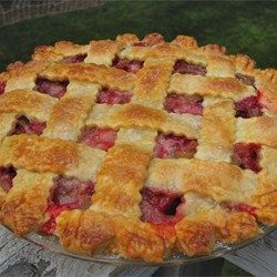 """Rhubarb and Strawberry Pie - Allrecipes.com.  1C white sugar, 1/2C all-purpose flour, 1lb fresh or frozen chopped rhubarb, 2 pints fresh strawberries, 2 9"""" pie crusts, 2T butter on top, 1 egg yolk brushed over crust, 2T sugar sprinkled over all."""