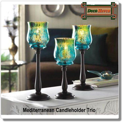 Mediterranean Candleholder Trio - A trio of gorgeous glass mounted upon sleek spindles of black metal, all with varying heights to create a stunning display. The iridescent blues and greens of the candle cups with sparkle with light upon your tabletop and make any evening bright with style.  Only $62.97 plus FREE shipping!