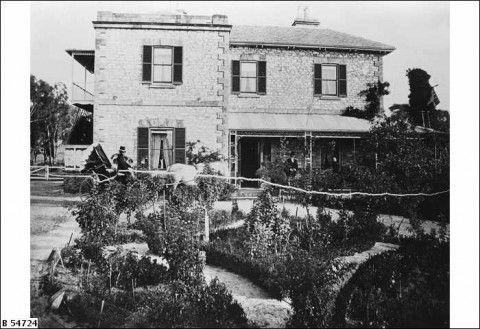 John Dunn standing on the verandah of: 'The Laurels', his residence at Mount Barker, c1880