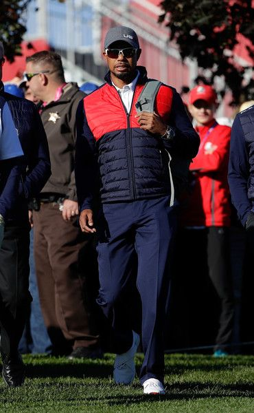 Vice-captain Tiger Woods of the United States looks on during team photocalls prior to the 2016 Ryder Cup at Hazeltine National Golf Club on September 27, 2016 in Chaska, Minnesota.