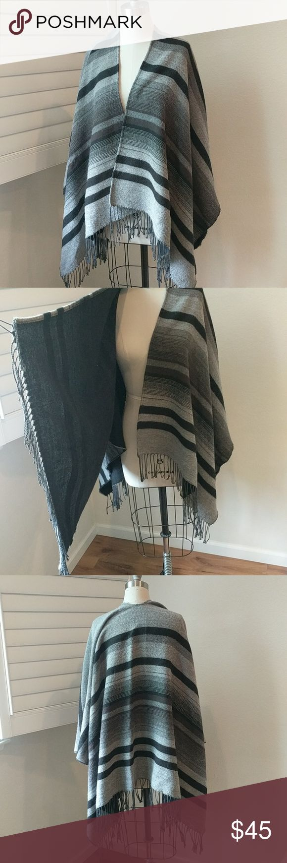 """Wool Grey Blanket Shawl with Tassles Black and grey wool blanket style shawl with yarn tassels in black. Super soft and cuddly wool, I'm 5'7"""" and the shawl tassels end at my knees. Unkown brand, must have lost the tag somewhere. Unkown Accessories Scarves & Wraps"""