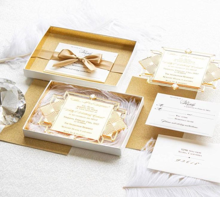 Perfect boxed invites complete with gold feathers