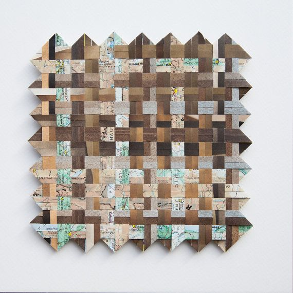 This paper weaving in shades of brown has been handmade from acid free printed paper and a map. The paper has been cut into 5mm ( .2 inch) strips and these have been woven in pairs to create a textured look. It is the original artwork and not a print. The weaving measures 16 cm square (6.3 inches).  It has been mounted onto 5mm foam core ( .2 inch) to give an interesting 3D effect and then framed in a deep shadow box frame. The white frame measures 25x25 cm square (9.8 inches) and is 4.5cm…