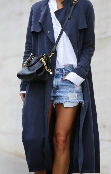 Navy trench, cutoffs, white blouse, and a cross body bag
